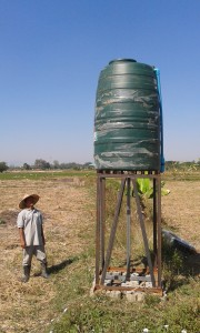 Our new farm worker next to our irrigation water tower.